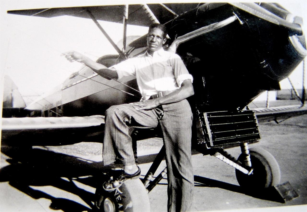 Frank Mann with a Waco Biplane
