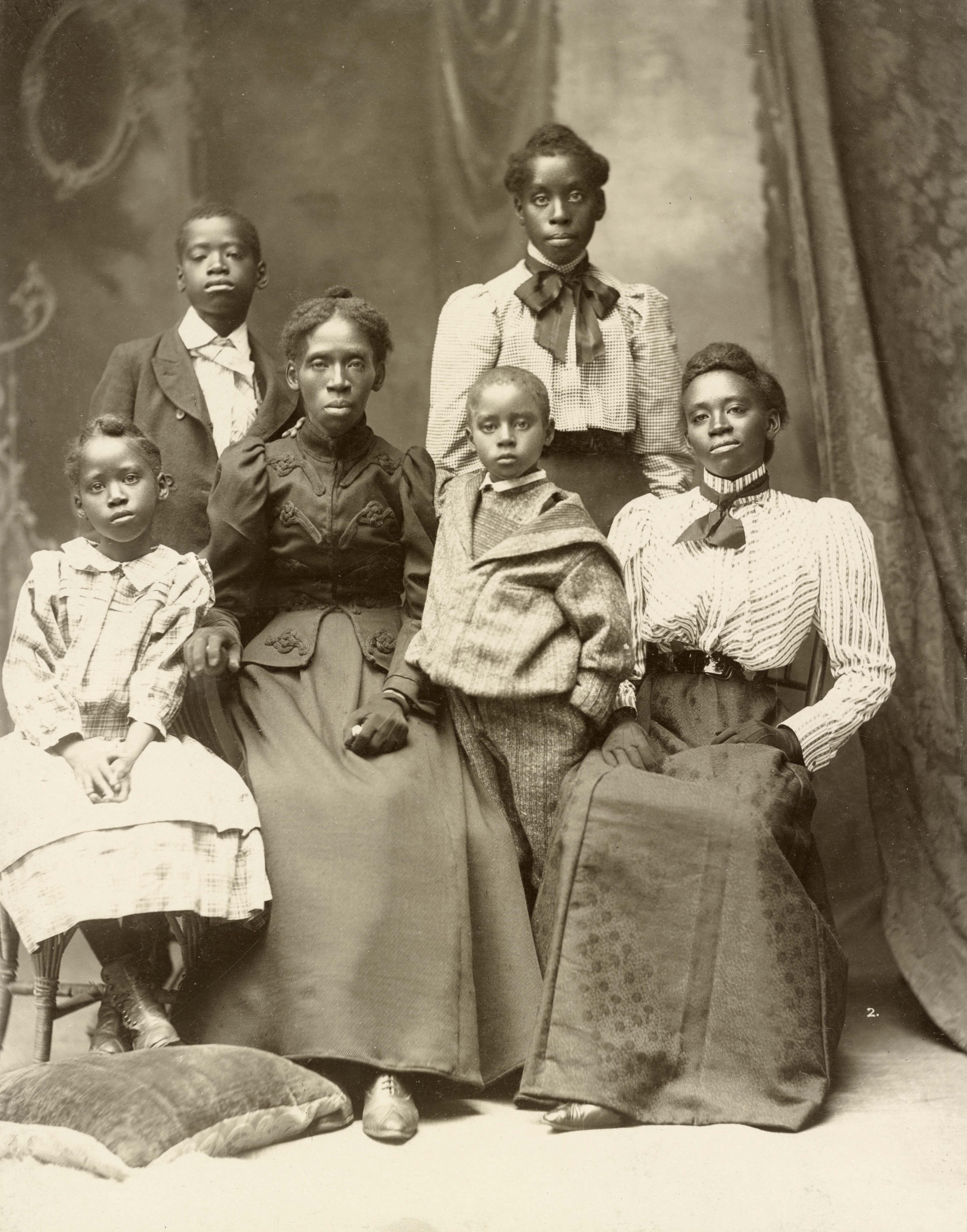 Mrs. Frazer Baker with her children, Lake City, August 18, 1899