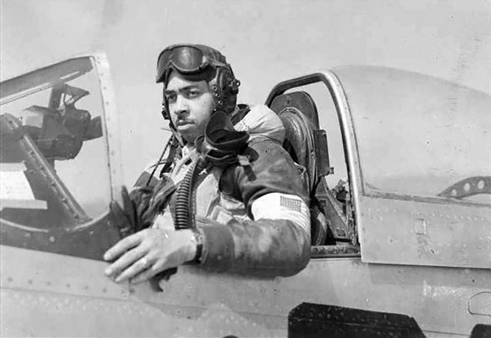 Jack in flight gear and sitting in aircraft cockpit