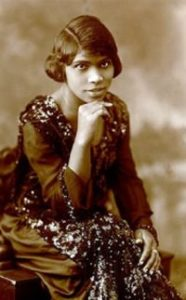 Faded black and white photo of Marian Anderson sitting and looking at the camera