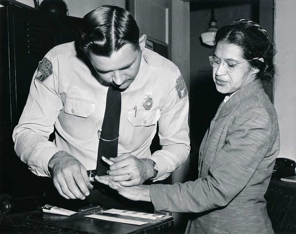 Rosa Parks being fingerprinted by Deputy Sheriff D.H. Lackey, Montgomery, Alabama, February 22, 1956