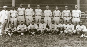 St. Louis Stars, 1927. Mule Suttles is fourth from left, front row and Cool Papa Bell is sitting at his feet.