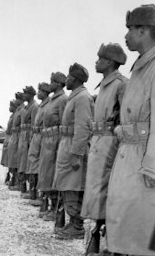 General of the Army Douglas MacArthur is shown inspecting troops of the 24th Inf. on his arrival at Kimpo airfield for a tour of the battlefront.  February 21, 1951.  INP.  (USIA) NARA FILE #:  306-PS-51-10432 WAR & CONFLICT BOOK #:  1375