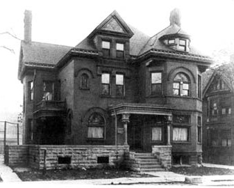 Old urban mansion-style home. Black and white photo.