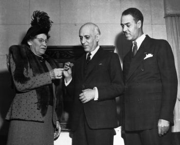 Mrs. Robert L. Vann presents gold medal and NAACP Life Membership to Indian Prime Minister Jawarhalal Nehru, as Roy Wilkins looks on, New York City, 1949