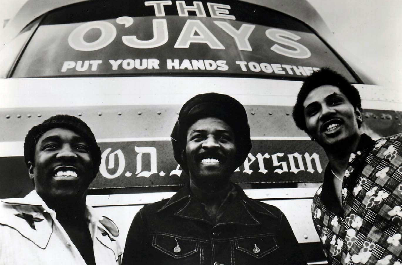 The O'Jays (from left: Eddie Levert, Walter Williams and William Powell) with custom touring bus, 1974